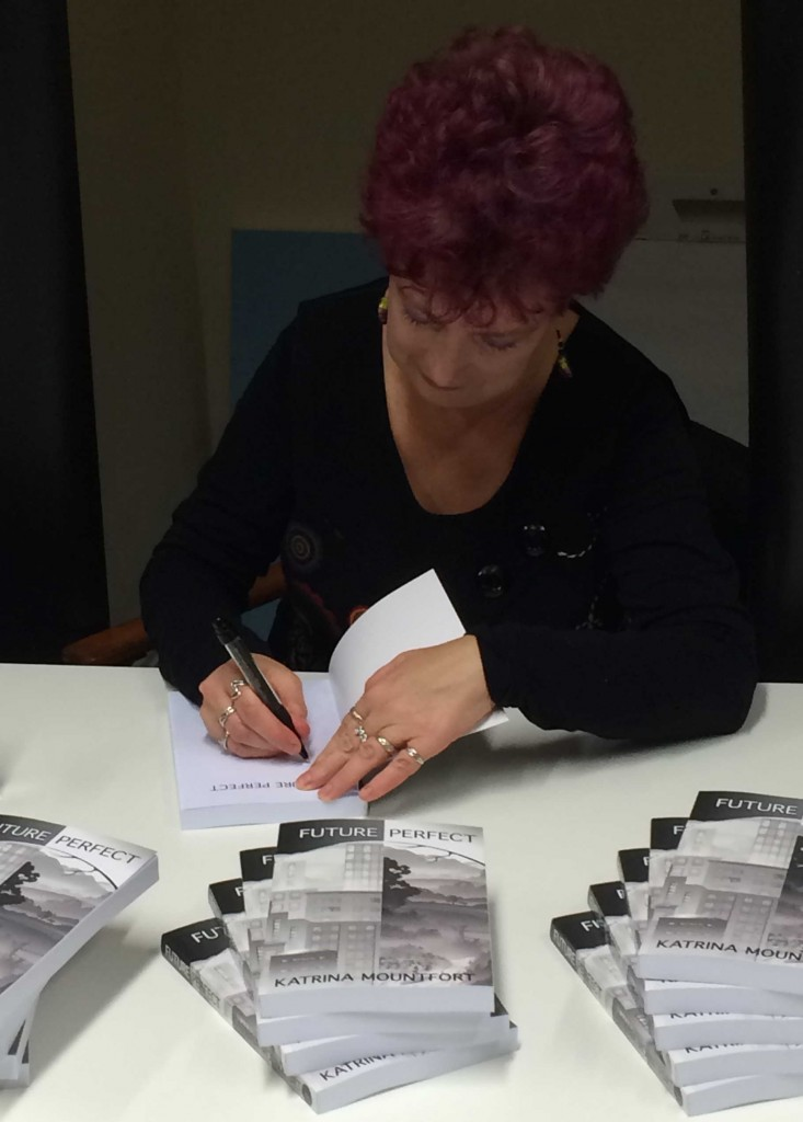 Katrina signing the first copy of Future Perfect