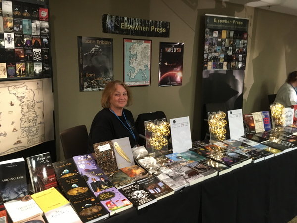 Our table at Nine Worlds with added fancy lights